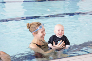 mum and smiling baby in pool